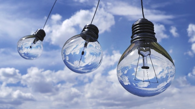 Light bulbs against the sky as an example of sustainability.