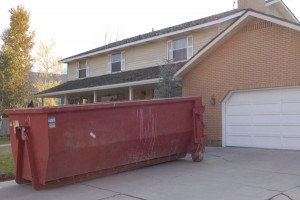 dumpster in driveway