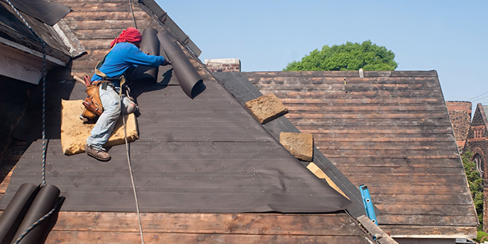 Man Completing a Roofing Project