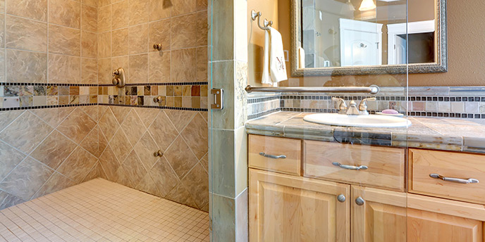 Luxury Bathroom With Tiled Shower and Sink