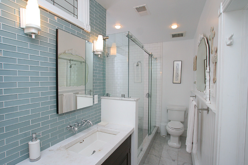 Small bathroom tile ideas to transform a cramped space for Large glass tiles for bathroom