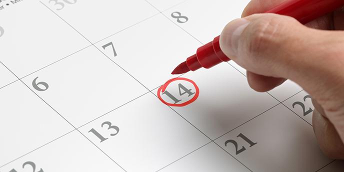 Man Circling Date on Calendar