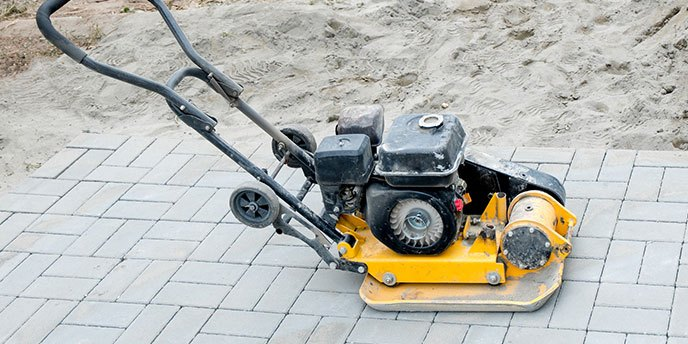 Plate Compactor On Top of New Paver Patio