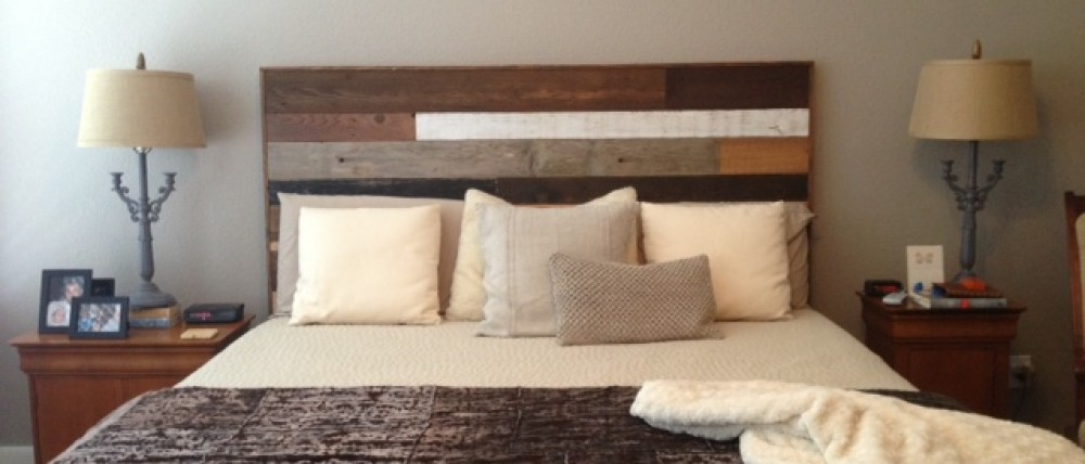 Completing a bedroom remodel with a custom headboard.