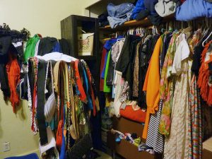 Clutter from blankets and seasonal clothing.