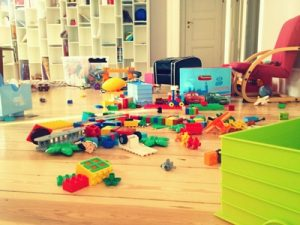 Toys scattered around a room.