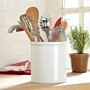 Get organized by storing utensils in containers.