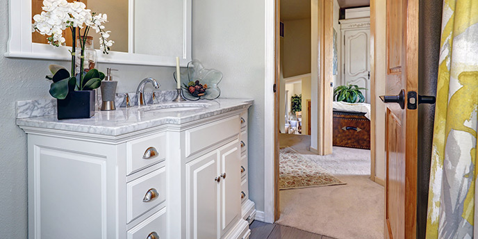 White Vanity Adds Storage to Small Bathroom