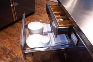 Pull-out shelf under-counter cabinetry.