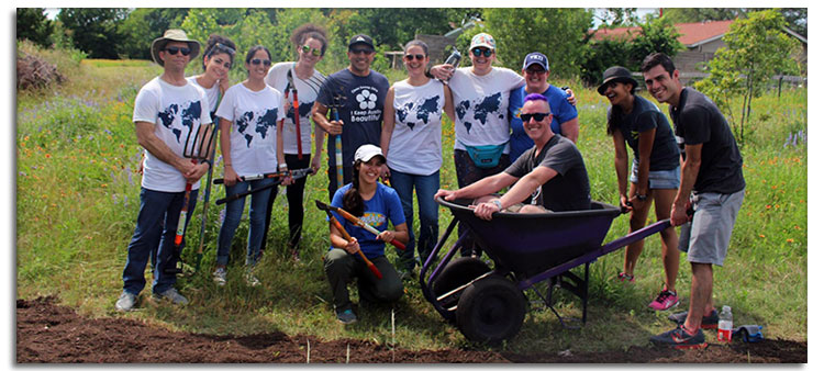 Volunteers for Keep Austin Beautiful Working in a Field