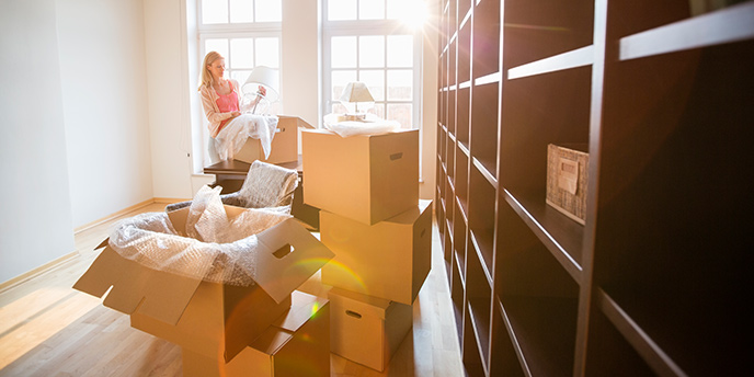 Woman Decluttering Before a Move