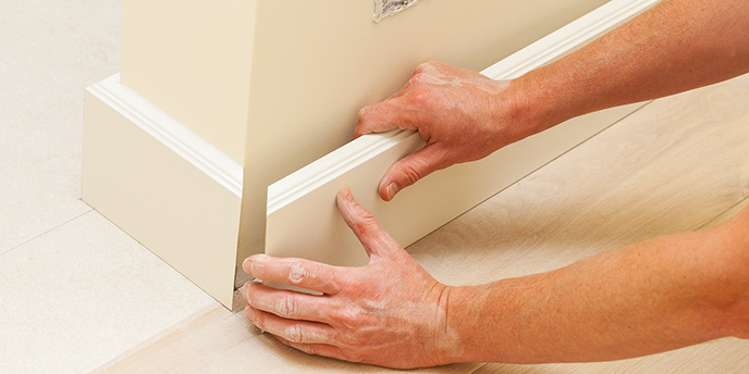 Baseboard Being Removed From a Wall