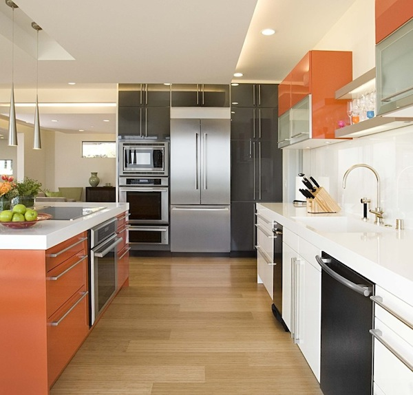A light hardwood floor adds space to a galley kitchen makeover.