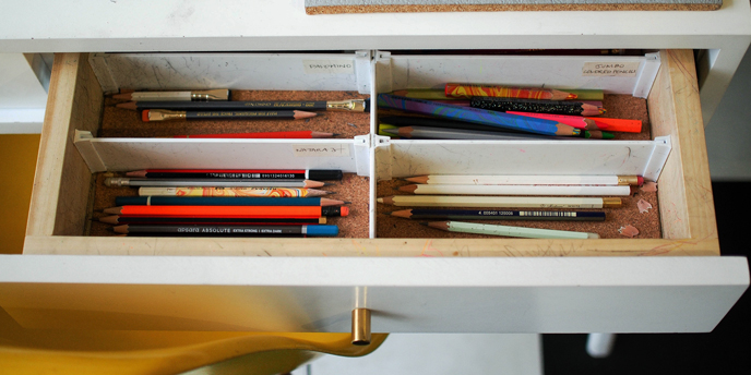 Open Drawer Full of Pencils Placed in Dividers