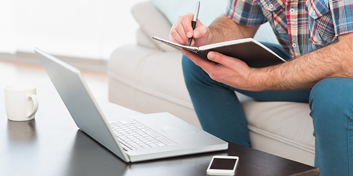 Man Building Remodeling Budget Spreadsheet