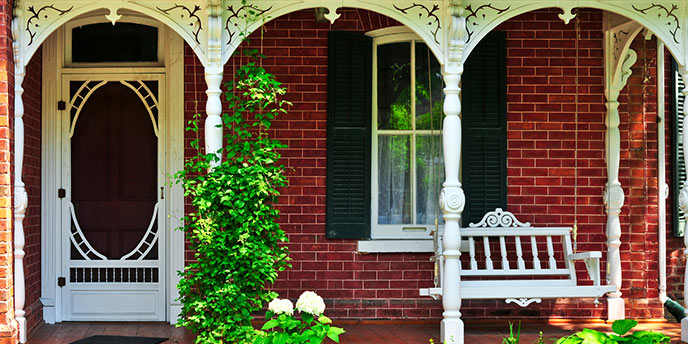 Brick House with White Porch Swing