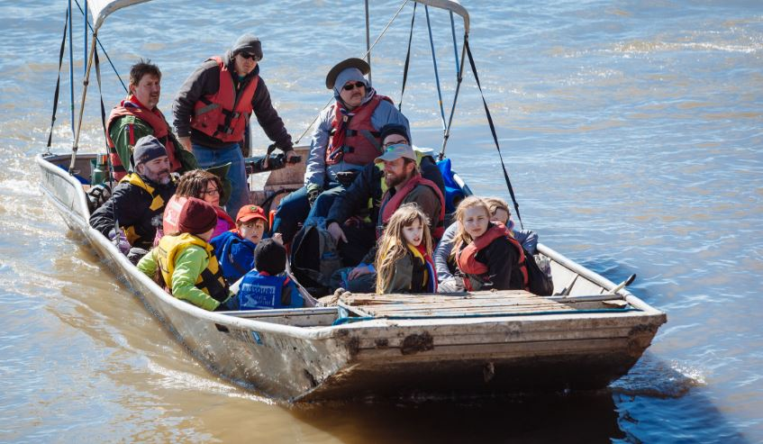 Great Rivers Greenway volunteers in a boat.