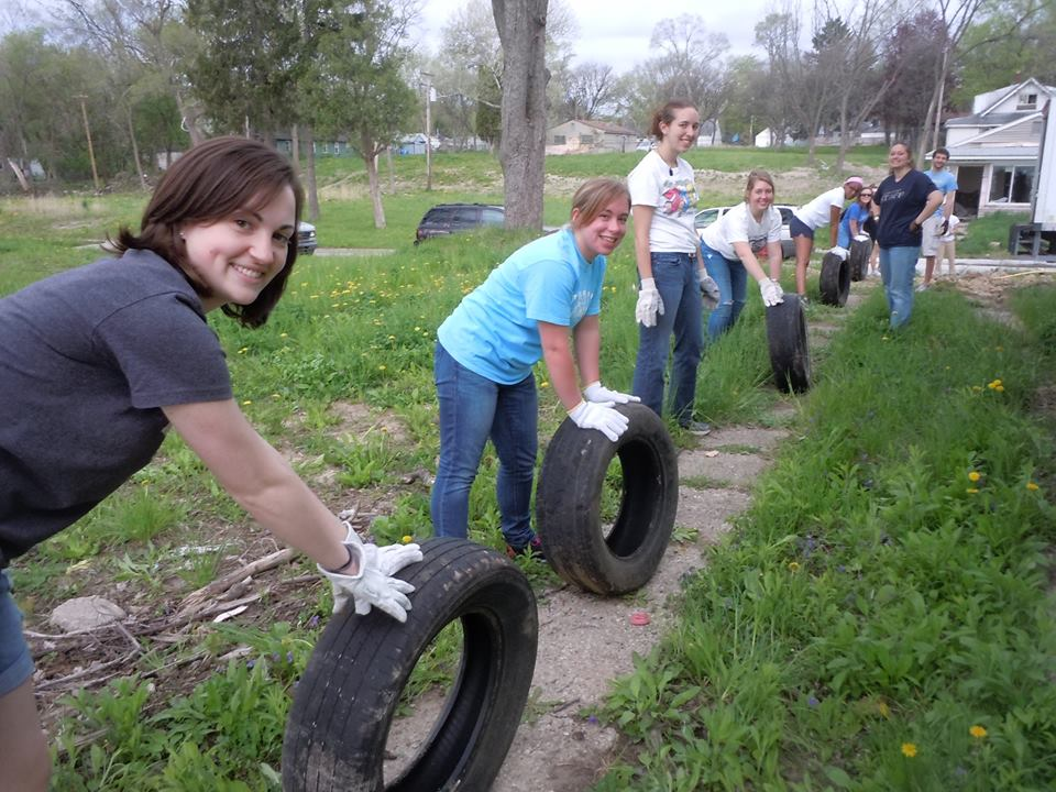 CCSS volunteers cleaning up tires.