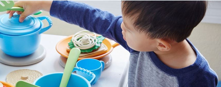 A child playing with eco-friendly toys.