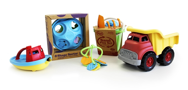A group of sustainable toys including a dump truck and a sorting game.