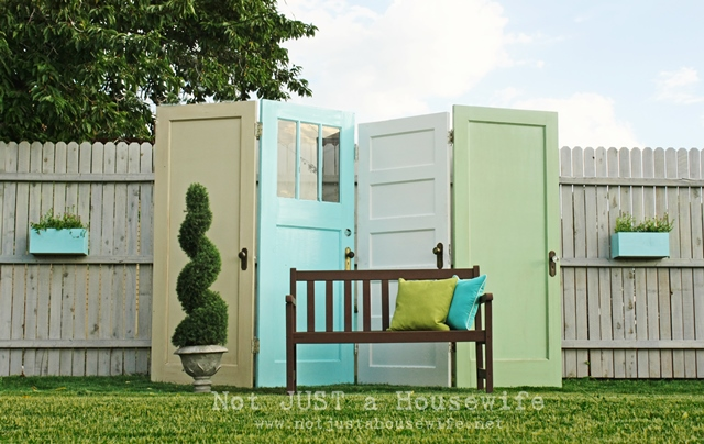 Old doors turned into a DIY backyard privacy screen.