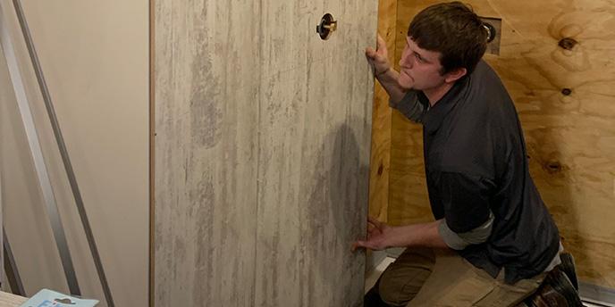 Man Preparing Walls During Bathtub Removal