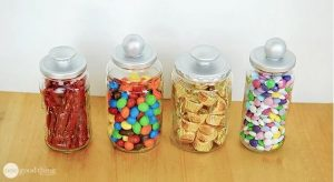Alt text: Reusing Glass Jars as Candy Jars With Silver Lids.