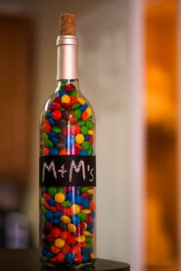 Bottle Full of Candy With a Strip of Chalkboard Paint, Labelled M&Ms.