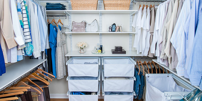 Organized Walk-In Closet with Shelving and Baskets