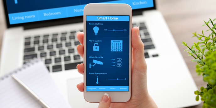 man Using Programmable Thermostat App