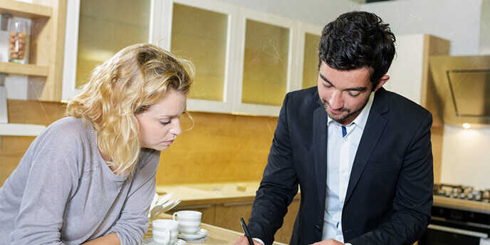 Woman Getting an In-Home Written Estimate