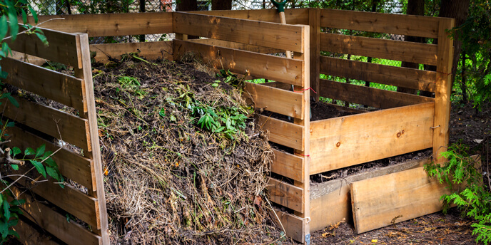 Two Homemade Wooden Compost Bins