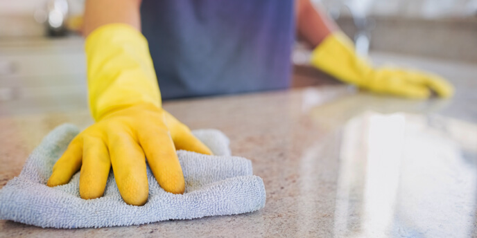 Woman Cleaning Up Countertops