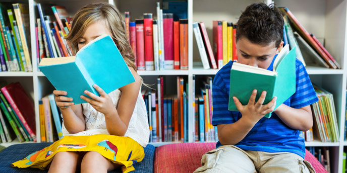 Children Reading in At-Home Playroom Library