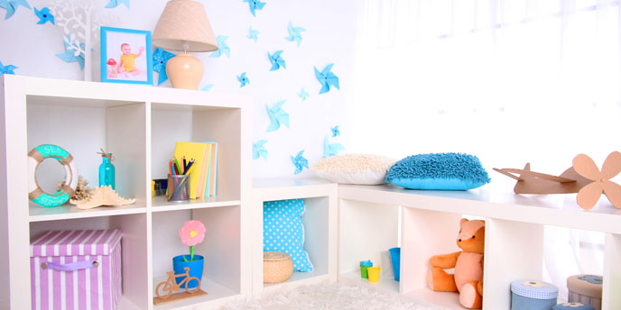 Bright Playroom with White Walls and Open Shelves Containing Children's Toys