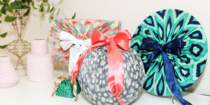 Four Differently Shaped Gifts In Lily Wrap