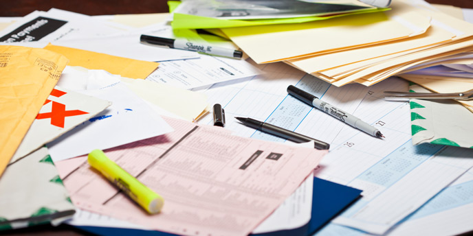 Bills, Receipts and Important Papers on a Messy Desk