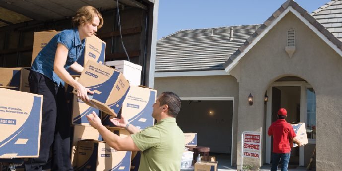 Family and Mover Unloading Boxes From Moving Truck