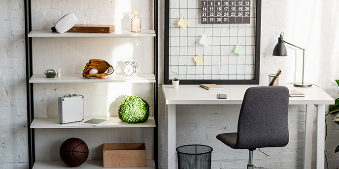 Office Desk and Shelving With Knickknacks