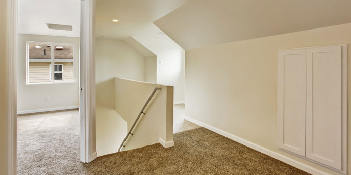 Upstairs Hallway With Door Open to Bedroom