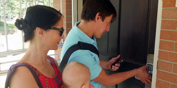 Family Checking Into Airbnb Via RemoteLock Front Door Lock