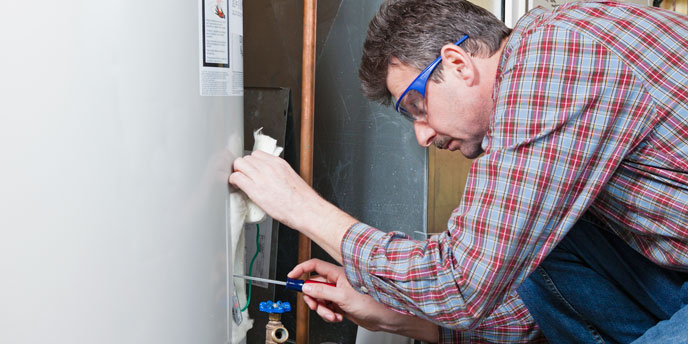 Hot Water Heater Being Examined by Repairman
