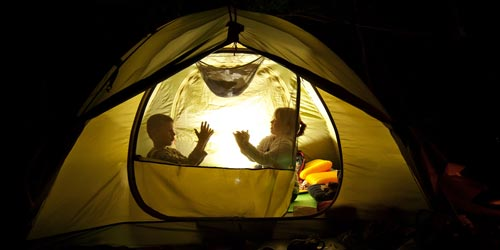 Two Kids Inside Tent Making Shadow Puppets
