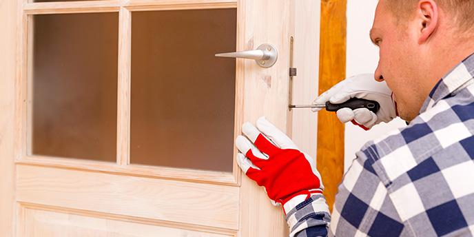 Man Fixing Exterior Door