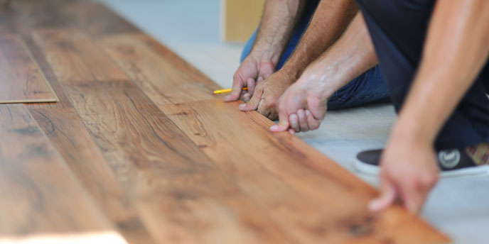 Men Installing Laminate Flooring
