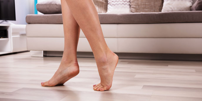 Woman Walking on Hardwood Floors