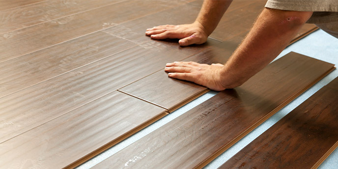 Man Installing Laminate Hardwood Floors