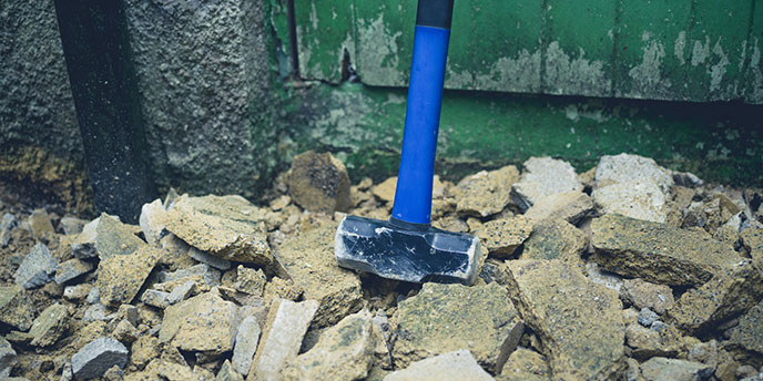 Blue Sledgehammer With Broken Concrete