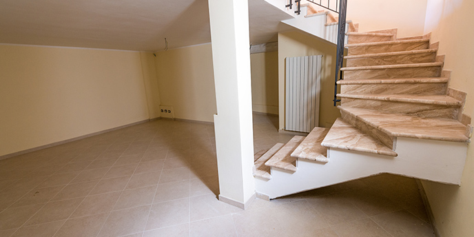 Staircase Leading to Uncluttered Basement Area