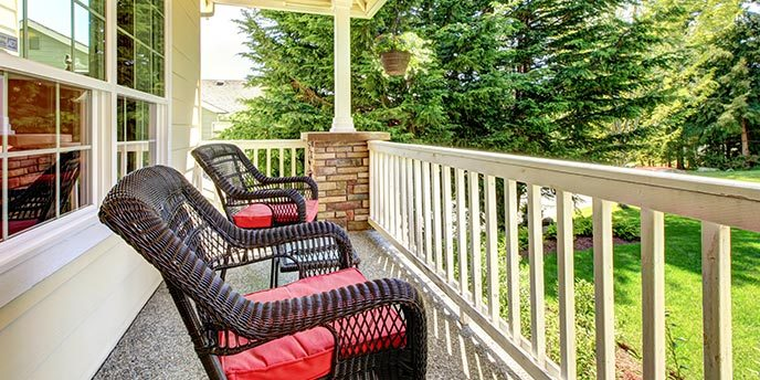 Wicker Chairs and Hanging Basket on Front Porch